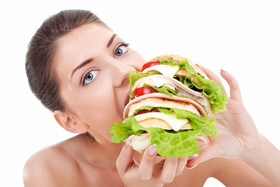 woman-eating-giant-sandwich